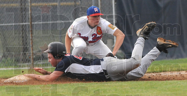 Tribune-Star/Rachel Keyes<br /> So Close: Caleb Mason reaches down for the tag out at third just a little to late in action Sunday.