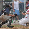 Tribune-Star/Rachel Keyes<br /> Home free: Zach Niehaus braces himself as he slides into home for a run in action Sunday.