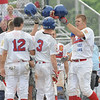 Tribune-Star/Rachel Keyes<br /> Home run: Teammates congratulate A.J. Reed after hitting a home run in late innings Sunday.