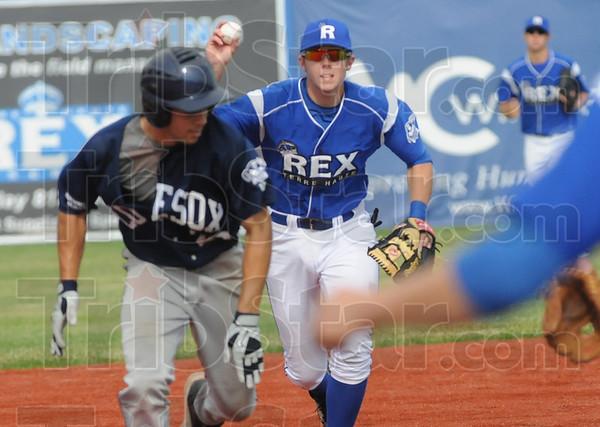 Tribune-Star/Rachel Keyes<br /> Tag out: The Rex's Derek Hannahs runs down a base runner in action Sunday.