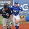 Tribune-Star/Rachel Keyes<br /> Tag out: The Rex's Derek Hannahs runs down a base runner in action Sunday.