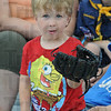Tribune-Star/Rachel Keyes<br /> Biggest fan: Three-year-old Zachary Fisher sits in the crowd waiting for his chance to catch a foul ball at Sunday's game.