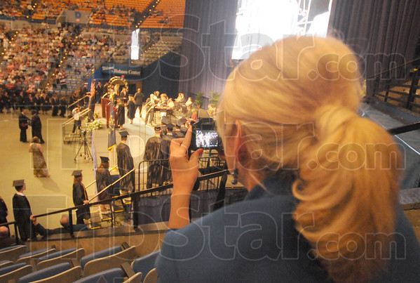 Tribune-Star/Rachel Keyes<br /> Proud mom: Donna Mansard snaps a shot of her Terre Haute South graduate son Grant Mansard and he crosses the stage to get his diploma.
