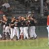 Tribune-Star/Rachel Keyes<br /> Celebrate: Terre Haute South's team celebrates after bringing the winning runs in Saturday's regional win.