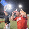 Tribune-Star/Rachel Keyes<br /> Cooler shower: Terre Haute South's Coach Kyle Kraemer pulls himself together after being dosed with a cooler of water Saturday after winning the Class 4A Regional Championship.