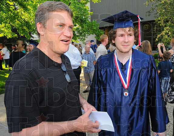 Tribune-Star/Jim Avelis<br /> Working it out: Craig Hedrick and his son Travis, just graduated from Terre Haute North, talk with Tribune-Star reporter Arthur Foulkes about their plans to pay for Travis' college.
