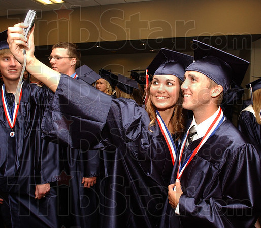 Tribune-Star/Jim Avelis<br /> Look at us: Megan Lemmons records her graduation with help from Justin Huxford just prior to commencement ceremonies.