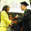 Tribune-Star/Rachel Keyes<br /> Mr. President: West Vigo's 2011 Class President Abel Watson receives his high school diploma Sunday afternoon.