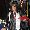 Tribune-Star/Rachel Keyes<br /> Nothing but smiles: Terre Haute South graduate Cache Ellis is nothing but smile as she walks down the stage with diploma in had.