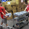 Canned help: Brandon Chamberlain and Austin Willis move canned goods into the Salvation Army food pantry Friday morning.