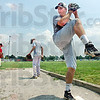High kick: South pitcher A.J. Reed throws some pitches during Friday's final practice session.