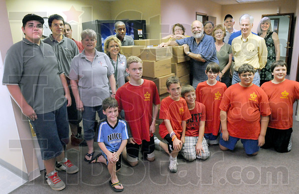 Food movers: A large group of volunteers pose for a photograph after moving several hundred pounds of groceries into the Salvation Army food pantry Friday morning.