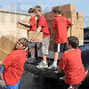 Scouts: A group of Boy Scouts from Troop #38 assist in loading a truck with food supplies at Baesler's Market Friday morning. The food is bound for the Salvation Army food bank.