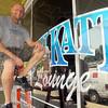 Tribune-Star/Jim Avelis<br /> On time: Jack Pluff sits outside the Blu Katt, downtown Terre Haute's latest business.