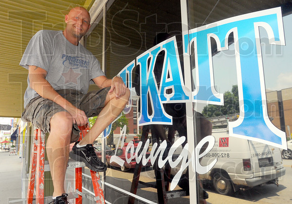 Tribune-Star/Jim Avelis<br /> On time: Jack Pluff sits outside the Blu Katt, downtown Terre Haute's latest business.