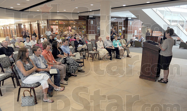 """Tribune-Star/Jim Avelis<br /> Connected: Cheryl Sisson, daughter of Burnita and Harold Hershfield, talks of growing up in the Union Hospital """"family"""" at the dedication of a garden named in her parent's honor."""