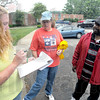 Tribune-Star/Jim Avelis<br /> Organizing: April Weddle helps sort out search areas for volunteers Pamela and James Higginson Saturday morning south of Indianapolis.