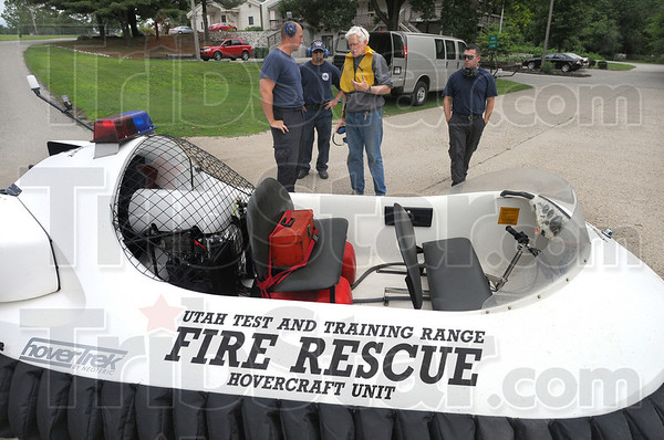 Tribune-Star/Jim Avelis<br /> Learning curve: Hovercraft instructor Chris Fitzgerald, center, talks with Cory Lingelbach, Derek Martinez and Jonathan Jiminez at the boat launch at Fairbanks Park. The three rescue workers are in town from Utah training with Fitzgerald.