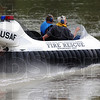 Tribune-Star/Jim Avelis<br /> Turn here: Chris Fitzgerald and Cory Lingelbach head upriver for a training exercise Friday evening.
