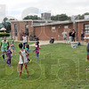 Fun: Volunteers and children from the Lockport Avenue housing project were treated to food, drinks and games after working to beautify the park area Friday afternoon.