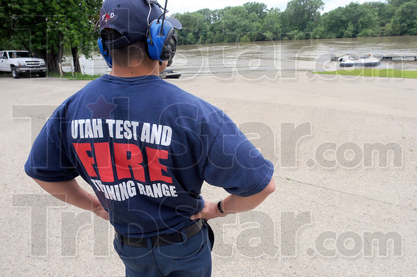 Tribune-Star/Jim Avelis<br /> Here to learn: One of the members from the Utah Test and Training range watches Chris Fitzgerald return the hovercraft to the landing at Fairbanks Park.