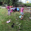 Beautification: A group of Girl Scouts and residents of the Margaret Avenue housing project work beautifying the park frontage Friday afternoon.