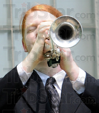 """Taps: Jake Nail of Terre Haute plays """"Taps"""" during Friday's memorial service at the Terre Haute Police Department."""