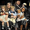 Tot time: Washington High School graduates and their children participate in the commencement ceremonies Friday evening.