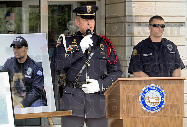 "Memorial service: Chief of Police John Plasse talks about K-9 ""Ben"" (photo left) and his service to our country and the City of Terre Haute during Friday's memorial event. At right is Ben's handler, officer Ryan Adamson."