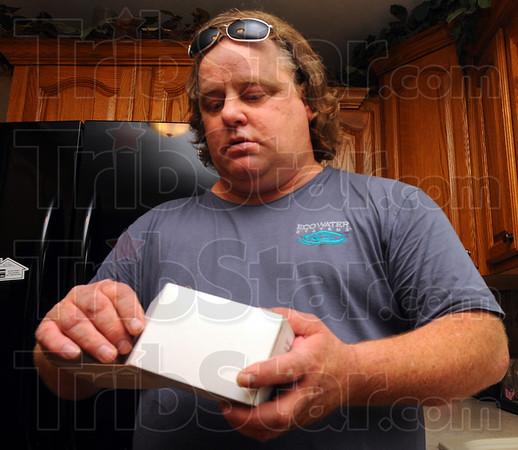 Tribune-Star/Jim Avelis<br /> Sample: Mike Byrd boxes the water sample taken from Gwen Mildazis' home on Frisco Avenue in Terre Town.