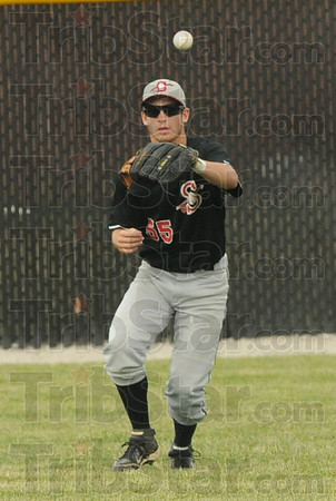 Tribune-Star/Rachel Keyes<br /> Easy out: Terre Haute South's Jacob Johnson prepares to catch a fly ball  for an easy out against Indianapolis Cathedral.