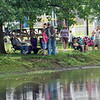 Fishing fans: Fishing fans line the banks of the Dobbs Park pond Saturday morning for the annual Fishing Rodeo.