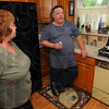 Tribune-Star/Jim Avelis<br /> Only aa test: Gwen Mildazis listens to Mike Byrd of Ecowater talk about what the testing of her well water will reveal.