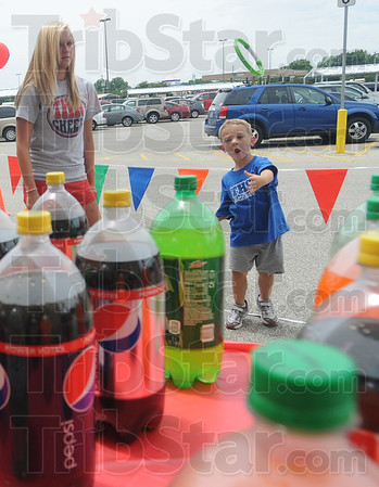Tribune-Star/Rachel Keyes<br /> Hook it: Three-year-old Mason Schafer checks out the ring toss game at a fundraiser for Riley Children's Hospital Saturday.