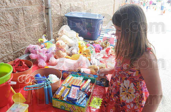 Tribune-Star/Rachel Keyes<br /> Spending Tickets: Seven-year-old Violet Vaghn spends the tickets she won at a fundraiser to benefit Riley Children's Hospital.