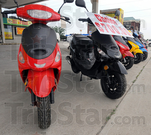 Tribune-Star/Jim Avelis<br /> Low end: While the Martins paid about $1,200 each for their mopeds, the small scooters can be purchased for $700 at some dealers.