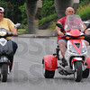Tribune-Star/Jim Avelis<br /> Scooting: Melony and Scott Martin ride south on 7th street near the I-70 overpass inb Terre Haute Tuesday afternoon.