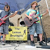 Tribune-Star/Rachel Keyes<br /> Musical Lemons: The Lemon Brothers band made up of Dylan Lemon (left) and  Logan Lemon (right) played at a benefit at Sam's Club Saturday funds raised while be donated to Riley's Children's Hospital.