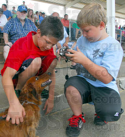 Picture this:  Elijah Lewis and Corbin Moseman photograph a dog during a break in the action of the Dachshund Dash Saturday morning that benefited the Wabash Valley affiliate of Susan G. Komen for the Cure.