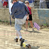 "Finish line: Justin Hayes is chased by his dog ""Heidi"" to finish the Dachshund Dash Saturday morning."