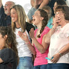 Good time: Spectators react to the action on the track during the Dachshund Dash Saturday morning at the Vigo County Fairgrounds.