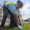 Tribune-Star/Rachel Keyes<br /> Clean up crew: Anthanique Cooper picks up trash around the court house lawn as part of a community service project at the NAACP Youth Summit Saturday afternoon.
