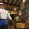 Tribune-Star/Jim Avelis<br /> Checking up: Mike Mervis walks through the receiving building where aluminum cans, scrap copper and extruded aluminum are brought in by the public.
