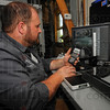 Tribune-Star/Jim Avelis<br /> Precision work: Flying S Inc. manufacturing engineer Peter Bowman uses a camera and computer to take measurements of some of the companys' work.