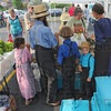 Tribune-Star/Jim Avelis<br /> Fresh from the farm: The Fisher family, Elam and his wife Mary, along with their children Isaac, Lavina and Christian brought fresh produce from their Parke county farm to the opening day of the farmers' market.
