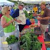 Tribune-Star/Jim Avelis<br /> Guidance: Debbie and Steve Humphrey chat with Chris Gambill, the President of Downtown Famers' Market Inc. on the opening day Saturday.
