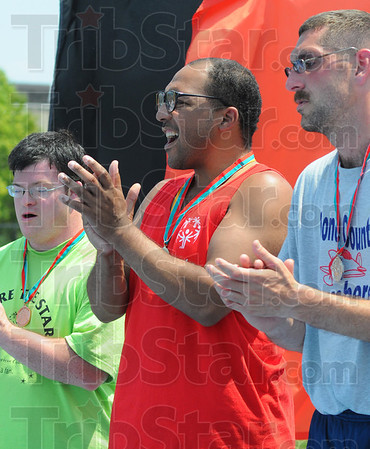 Tribune-Star/Jim Avelis<br /> Strongest: Lennon Beasley of Monroe county recieved a gold medal for his efforts in the shot put.