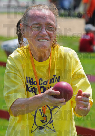 Tribune-Star/Jim Avelis<br /> Having a ball: Judy Calrk takes aim in the bocce ball tournament that is part of the Special Olympics competition that concludes today.