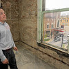 Tribune-Star/Jim Avelis<br /> Room with a view: Jason Widen stands near the front of the third floor in the new Radio City Loft Apartments. Looking over South 7th street between Ohio and Walnut streets, renters will be near the heart of downtown Terre Haute.