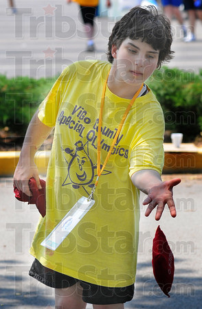 Tribune-Star/Jim Avelis<br /> Quiet time: Sarah Pemberton takes time out from competition in the Special Olympics to play cornhole.